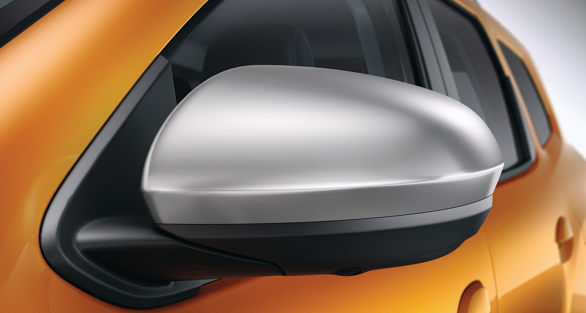 Світло-сріблясті корпуса зовнішніх дзеркал заднього огляду