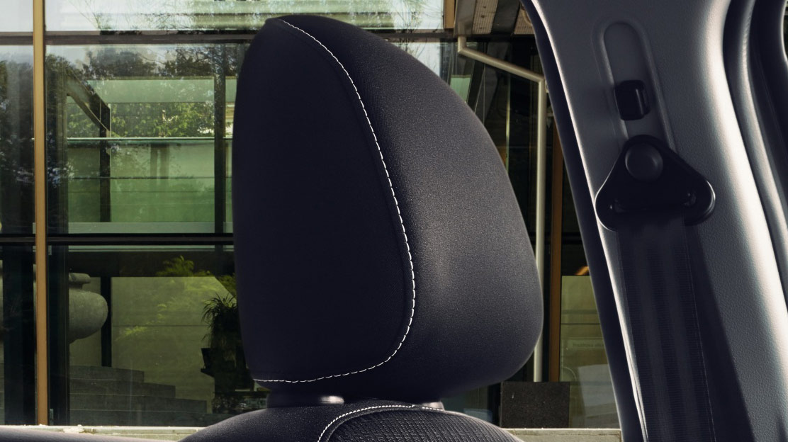 Height adjustable front headrests