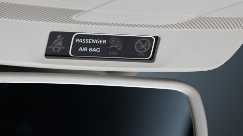 Ontkoppelbare passagiersairbag met geprogrammeerde ontplooiing