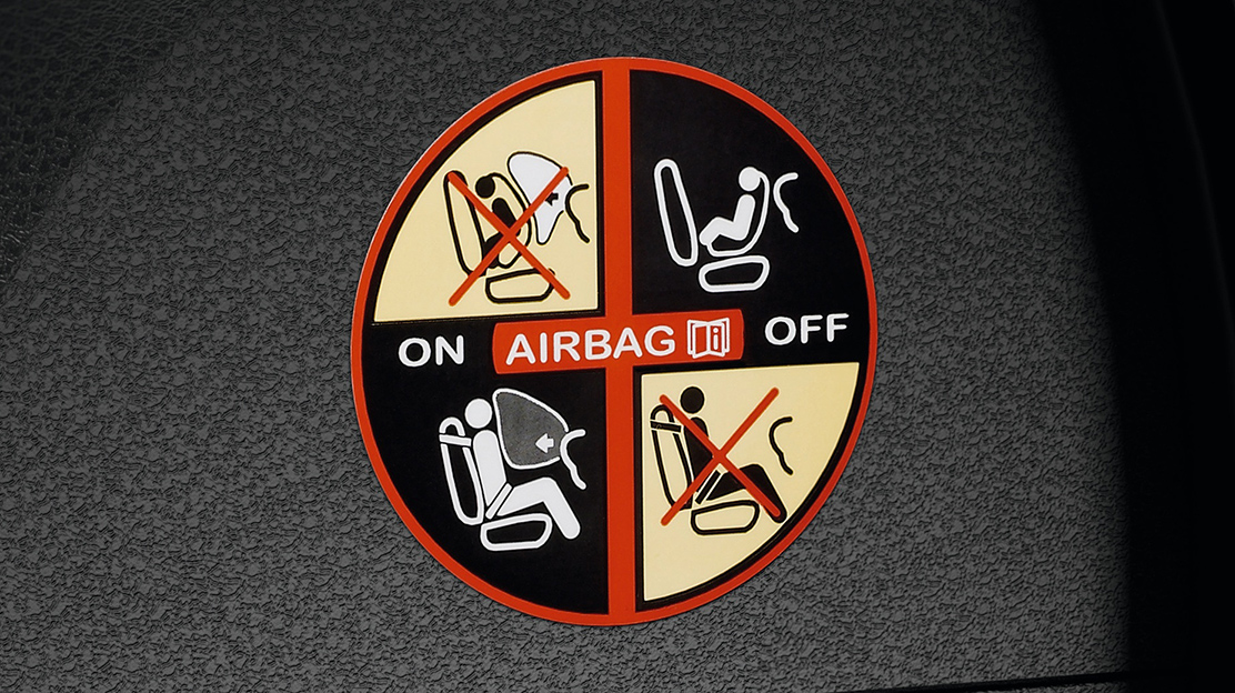 Passenger airbag with de-activation function