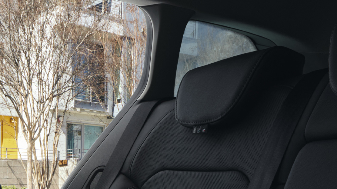 Headrests - rear - three height adjustable